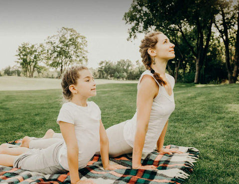 Woman and child doing yogo