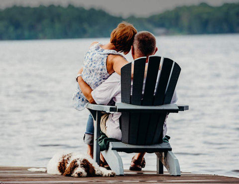 Man and woman gazing at lake