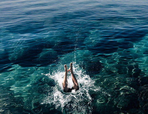 Person diving into ocean