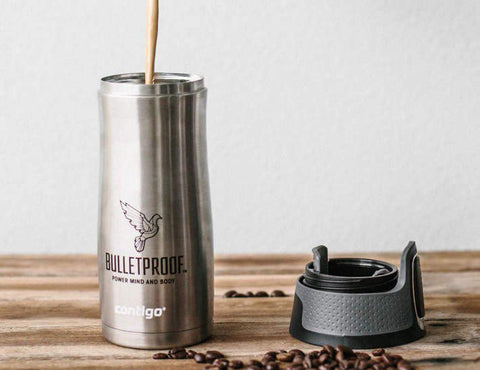 Bulletproof Coffee being poured into Bulletproof Travel Mug