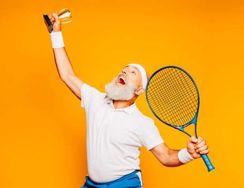 Man raising a tennis trophy