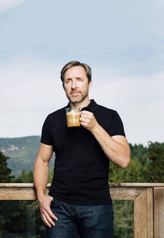 Bulletproof CEO Dave Asprey holding cup of Bulletproof Coffee