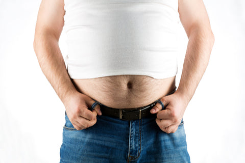 man overbelly fat wearing white under shirt and jeans