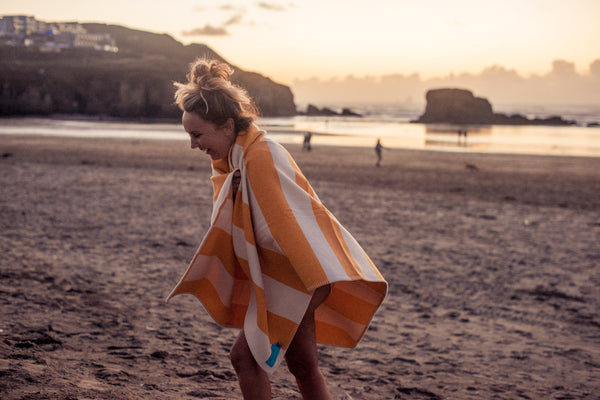 sea dipping and blankets