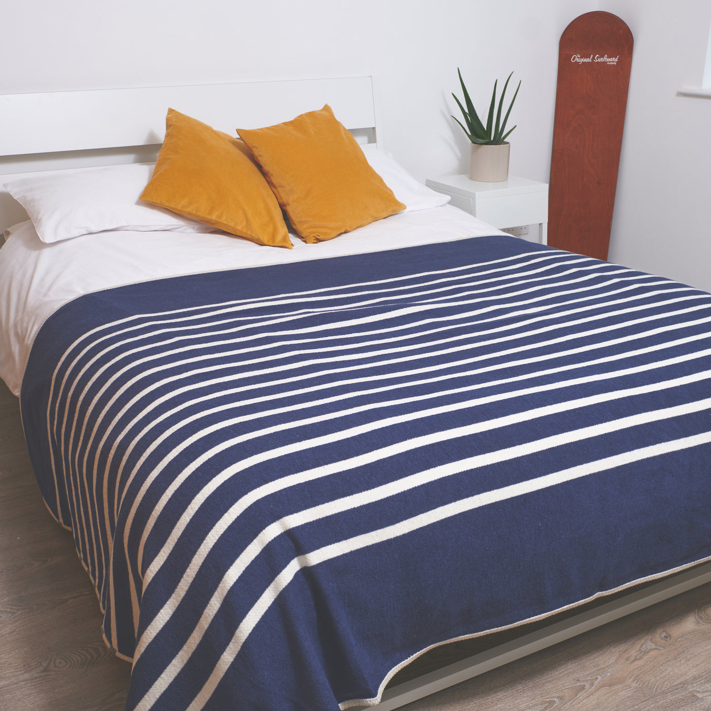 king sized bed blanket in a navy and cream stripe design