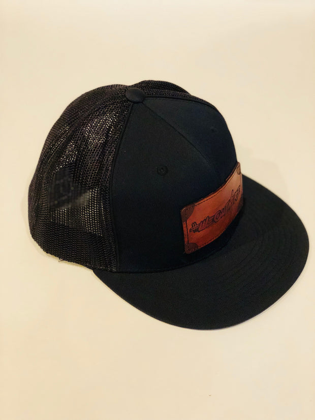#WeOutHere™ DARK LEATHER LOGO (Black) MESH FIT HAT