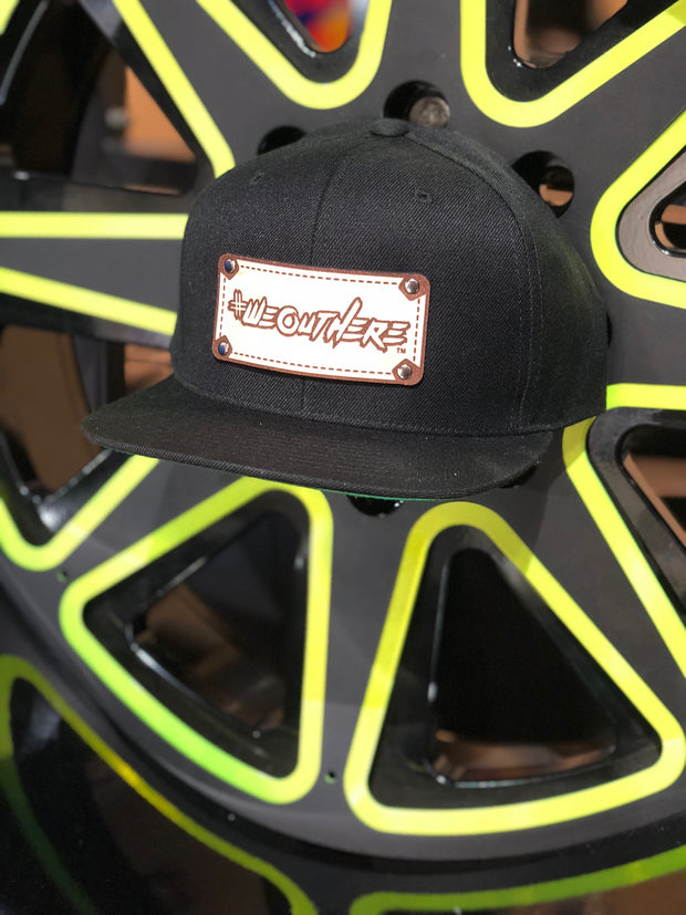 #WeOutHere™ LOGO ENGRAVED NATURAL LEATHER // SNAP BACK HAT (Black)