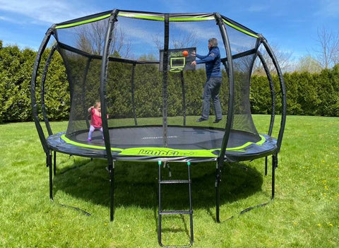 Adult playing with a toddler on a Jumpflex trampoline