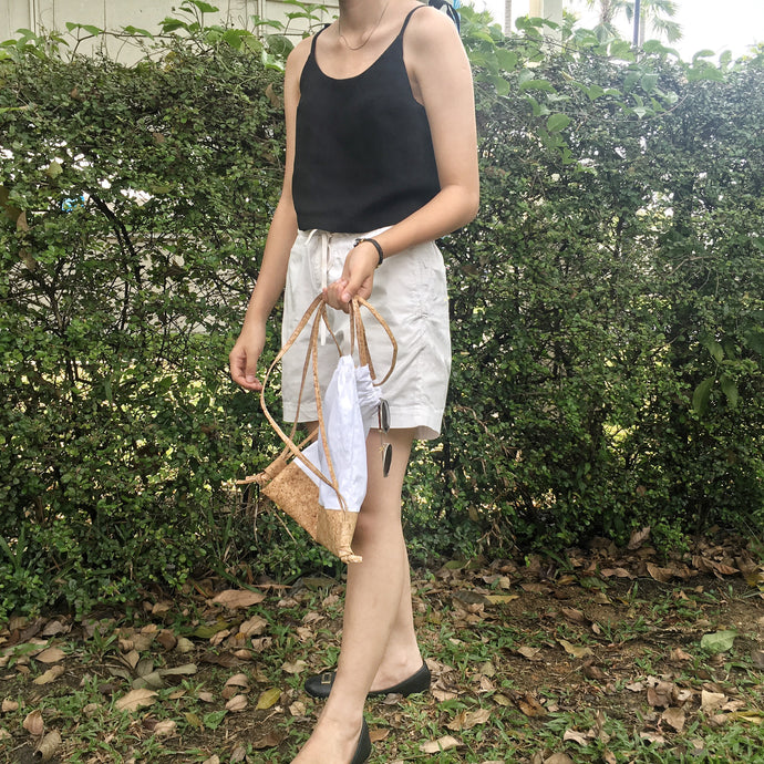 black tencel linen crop top with muji white cotton summer utility shorts with pockets cork drawstring bag and tie on shoulder straps