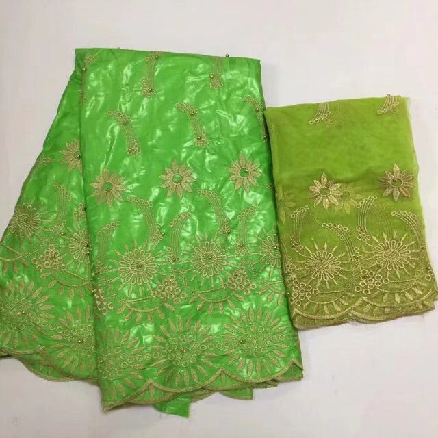Latest Bazin/ brocade set  ( 5 yards Bazin + 2 yards net lace, total 7 yards )