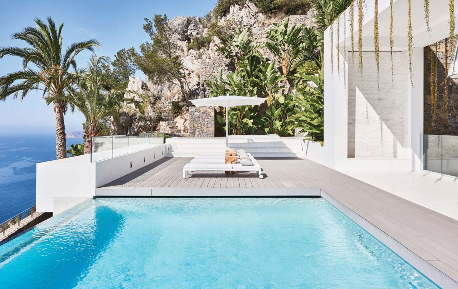 Spanish Villa Sun Loungers, Outdoor Space Ideas | Eric Kuster | Read more in The Luxurist | LuxDeco.com