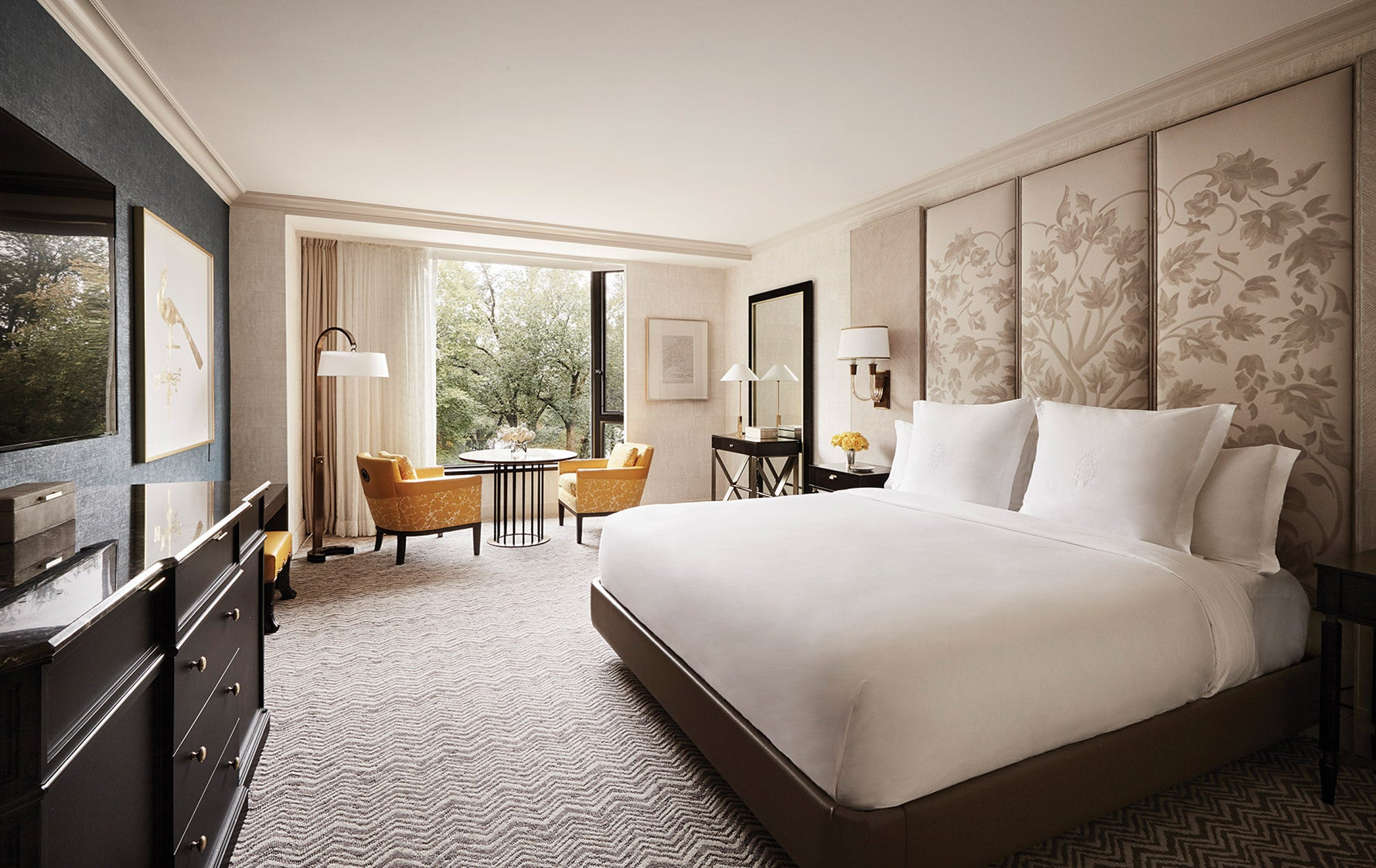 Headboard Alternatives | Upholstered Wall Panels | Four Seasons Boston bedroom | Luxury Bedroom Design |Read more in the LuxDeco.com Style Guide