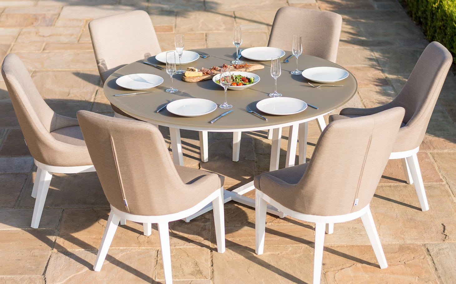 Invest in high-quality garden furniture - 8 Outdoor Dining Ideas - LuxDeco Style Guide