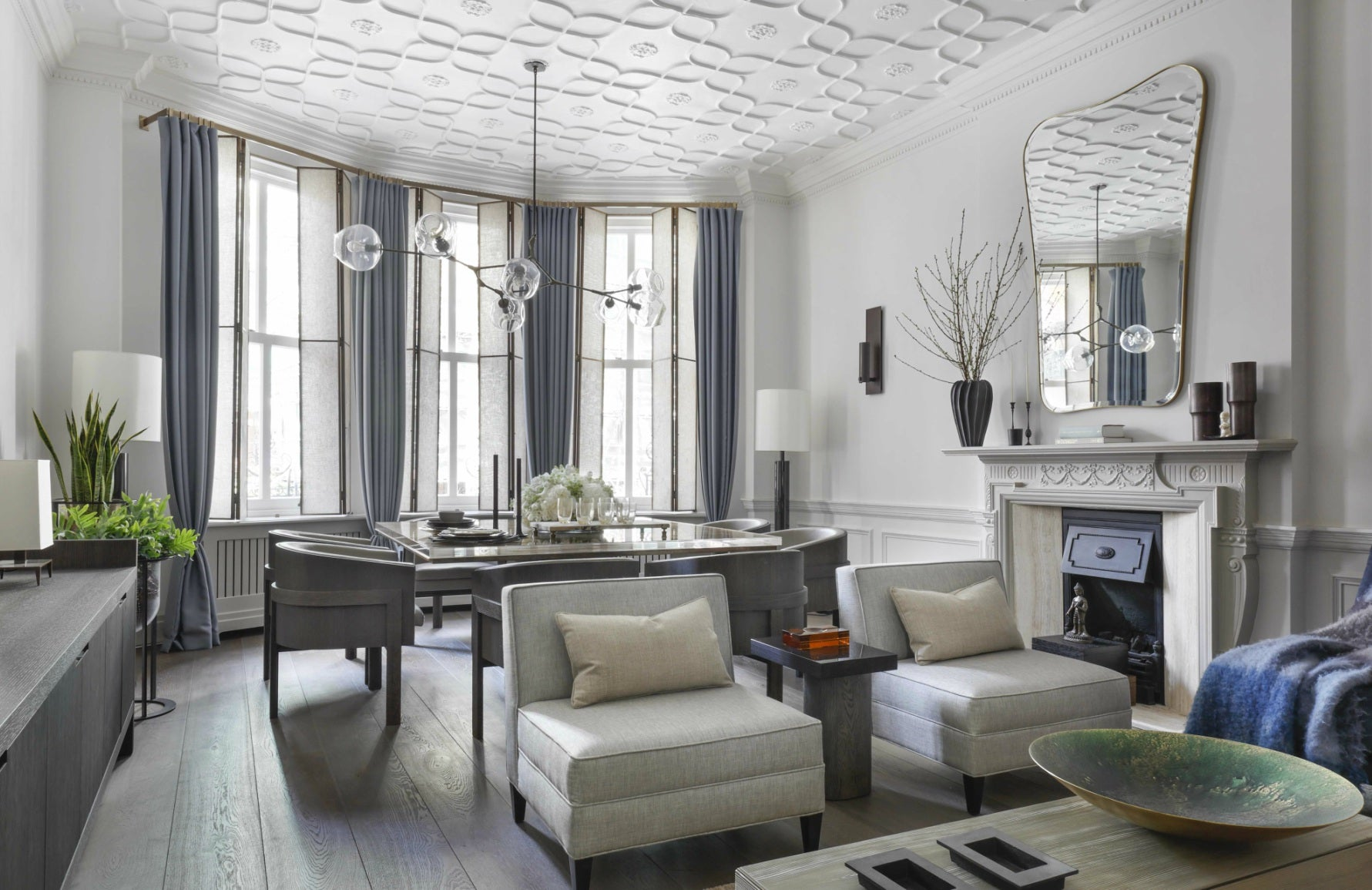 Janine Stone interiors | White and blue living room | Read more in The Luxurist