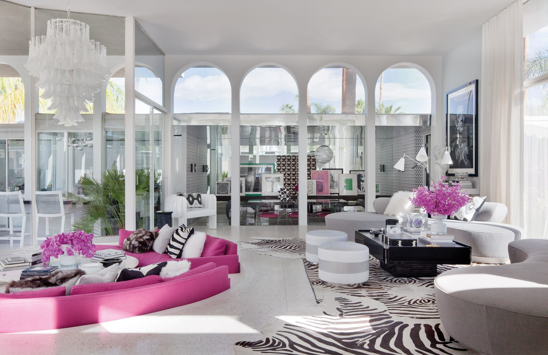 Martyn Lawrence Bullard home | Celebrity interior designer | Pink and white living room | Read more in The Luxurist at LuxDeco.com