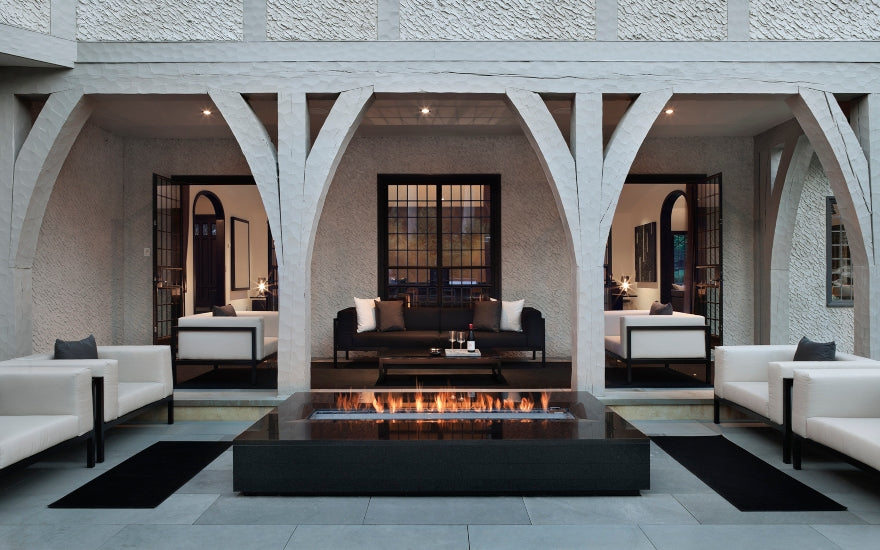 Outdoor Firepit - 8 Outdoor Lighting Ideas to Illuminate Your Garden - LuxDeco.com Style Guide
