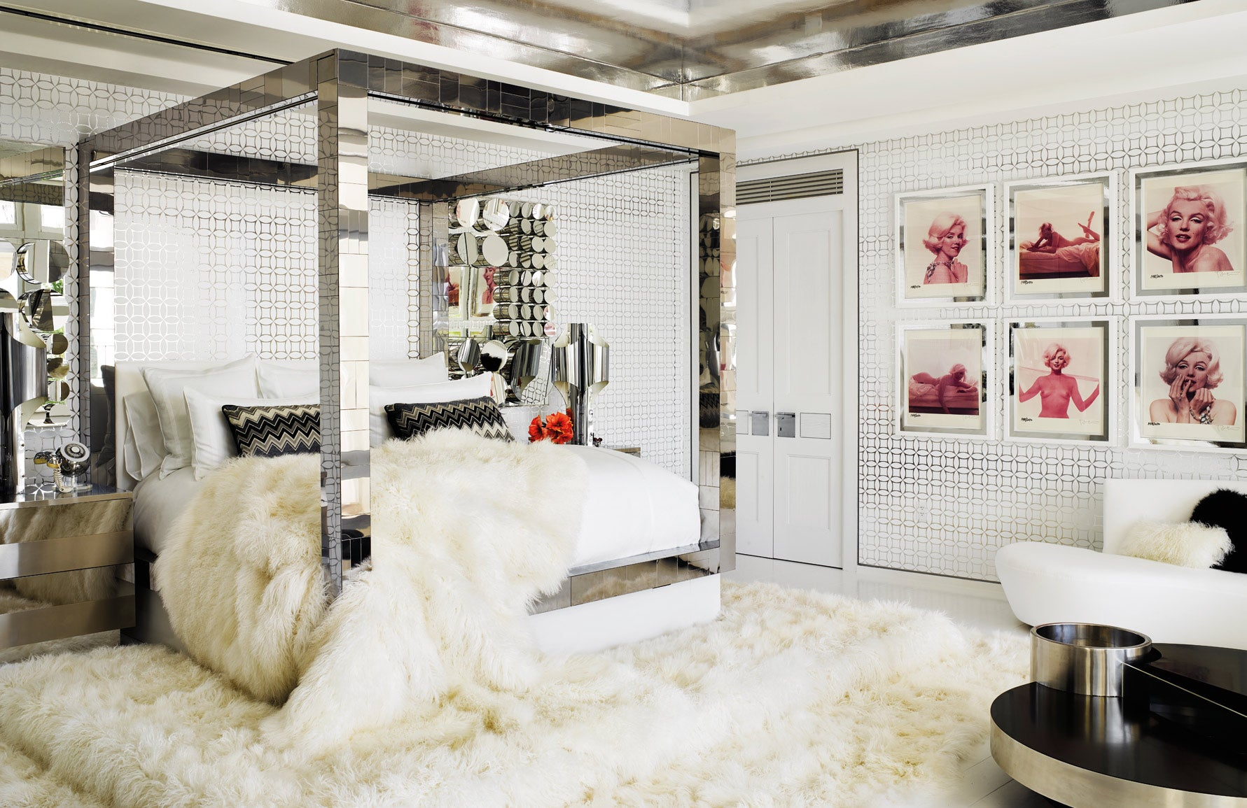 Tommy Hilfiger bedroom | Martyn Lawrence Bullard | Celebrity Interior Designer | White Bedroom, White Fur Rug, Four Poster Bed | Read more in The Luxurist at LuxDeco.com