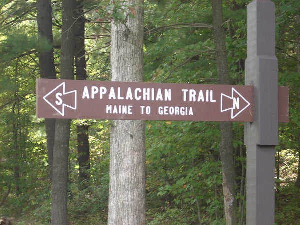 Wooden sign on the Appalachian Trail the says Maine to Georgia