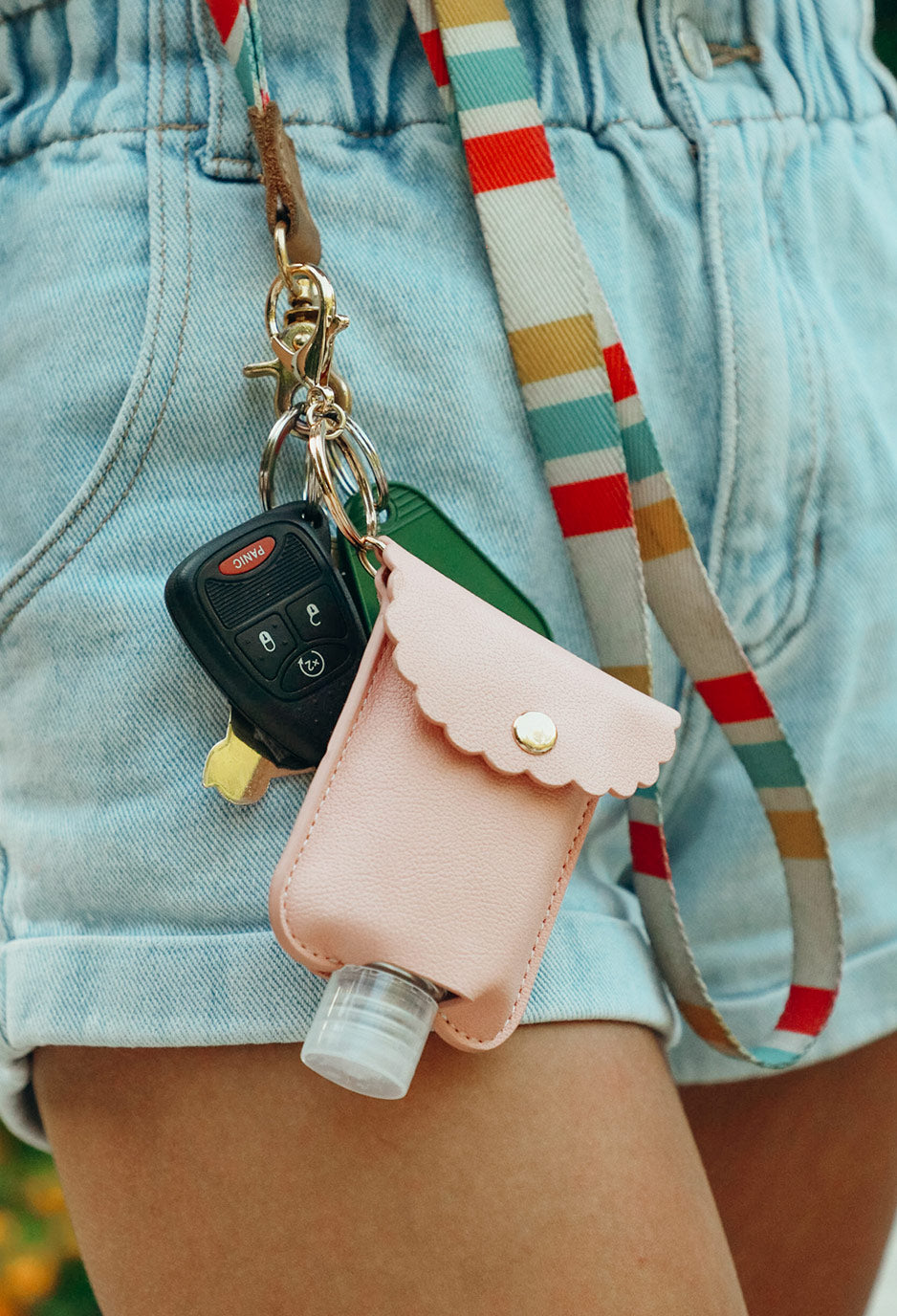 image of pink hand sanitizer case on key ring