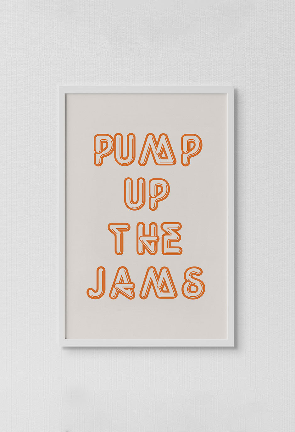 image of words that read pump up the jams in orange text with off white background in white frame on white wall.