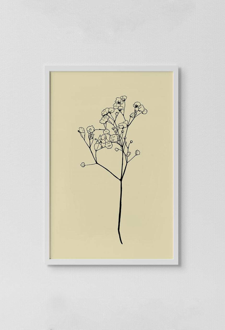 image of black tree stencil drawing with beige background in white frame on white wall.