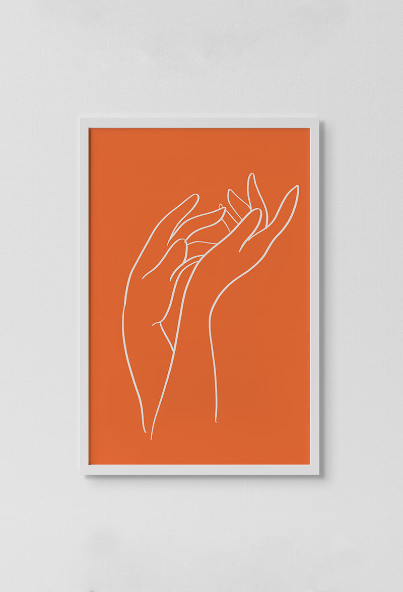 image of print of stencil drawing of two hands touching drawn in white on orange background in white frame on white wall.