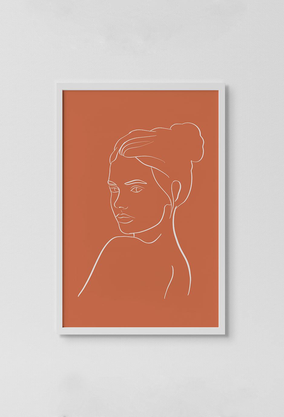 image of print of stencil drawing of a lady with a bun in white with orange background in white frame on white wall.
