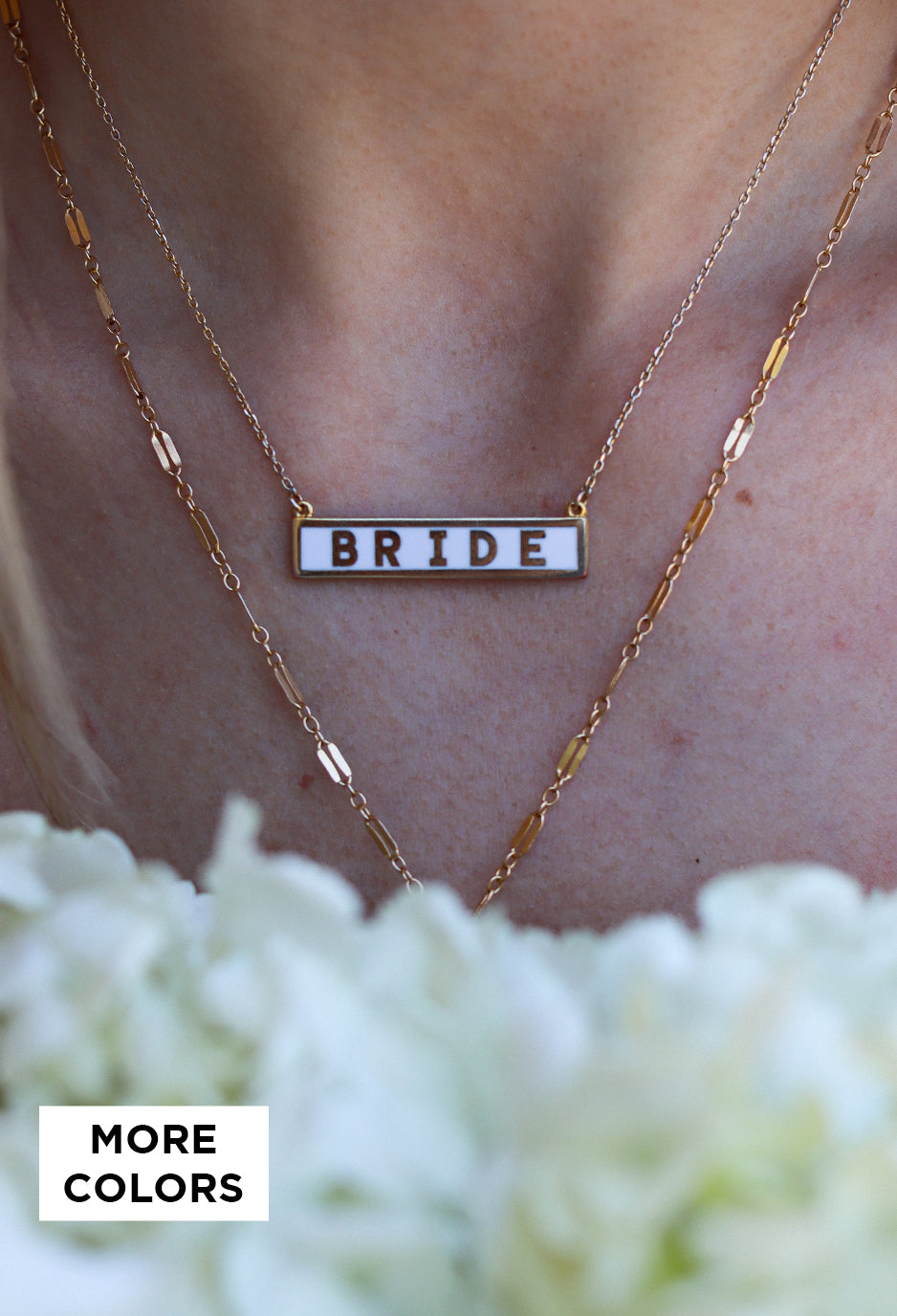 girl wearing black and white turtle neck and black acid washed jeans smiling looking away from camera