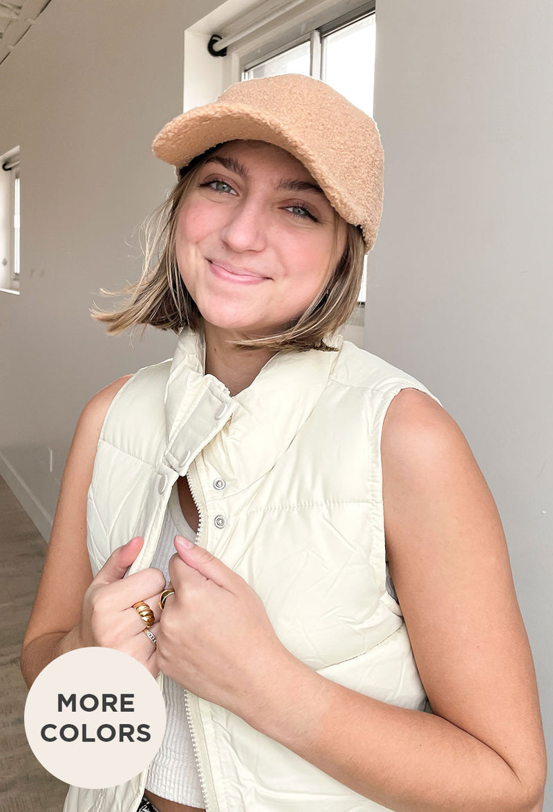 girl holding hands together in front of chest showing gold ring sets on fingers