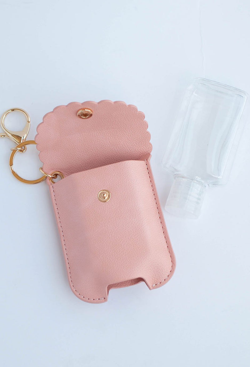 laydown image of hand sanitizer case and bottle next to it