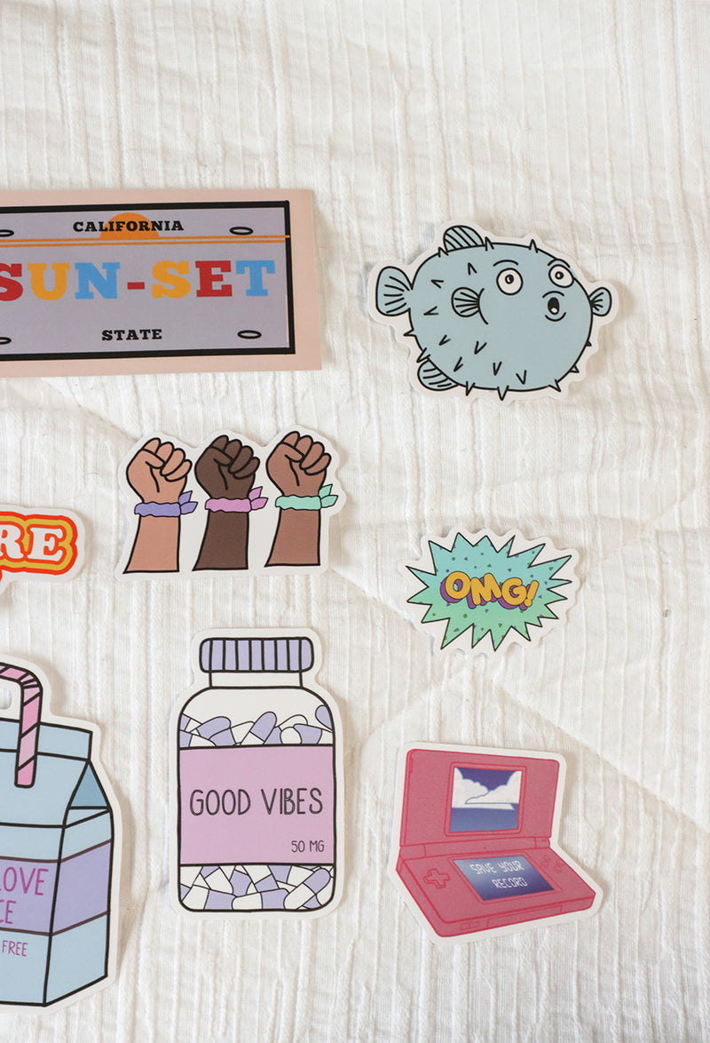 close up image of half set of bright sticker set on white background