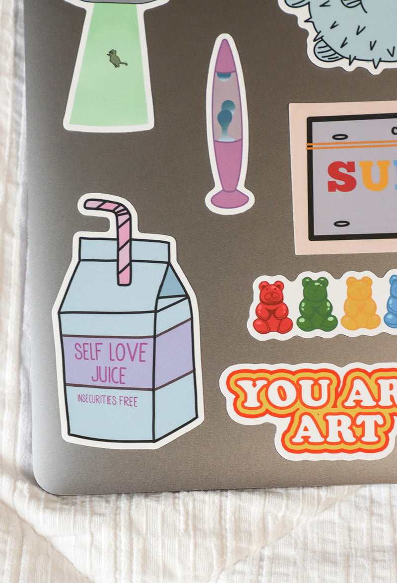 close up image of stickers in bright sticker set on laptop