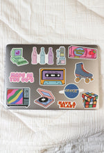 image of 12 stickers on laptop showing various retro images
