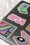 side angle image shot of stickers on laptop showing various retro images