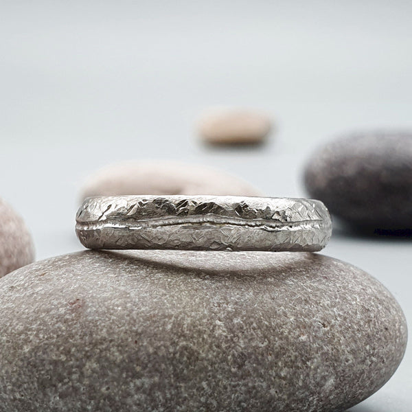 Designer thin white gold wedding ring, Carrock Fell hammered band.