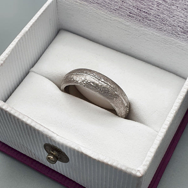 Designer broad white gold wedding ring, Carrock Fell hammered band.