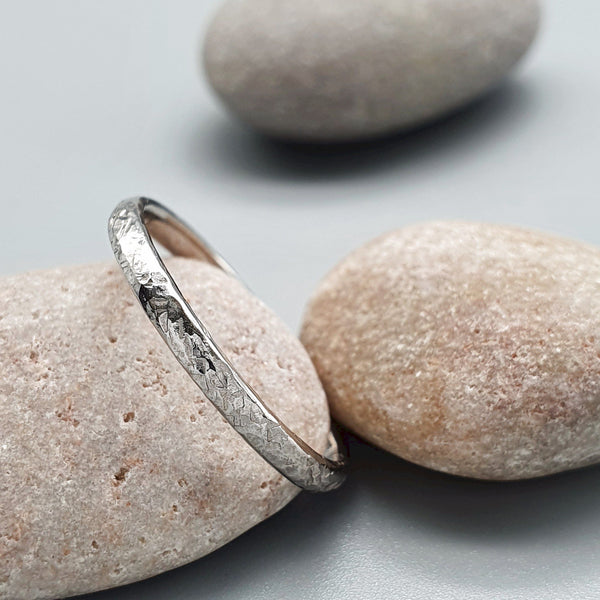 Wedding ring, thin white gold Fire hammered design