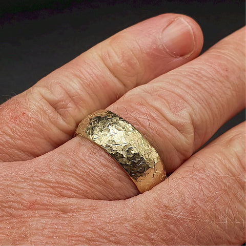 Wedding ring, broad yellow gold Fire hammered design