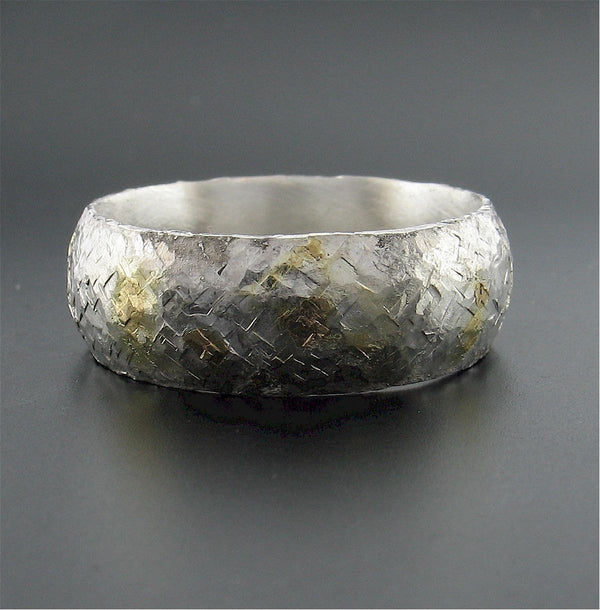 Silver and gold Sunrise 8mm court wedding ring with rustic hammered surface. Original design handmade band for a man