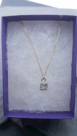 1ct uncut diamond necklace with gold chain.
