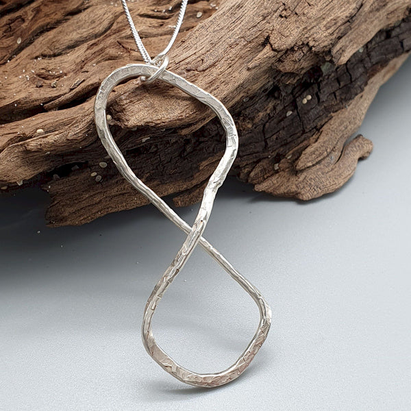 Silver Infinity hammered pendant - Cumbrian Designs