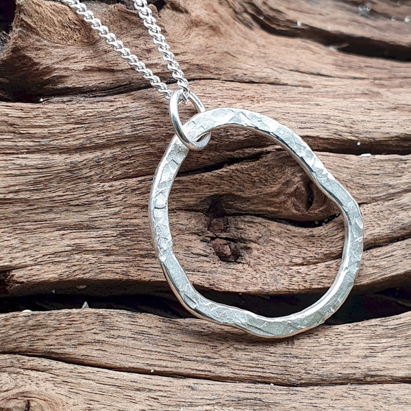 Hammered circle silver small pendant - Cumbrian Designs