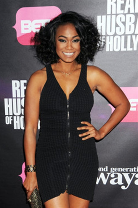 "Tatyana Ali from premier of ""Real Husbands of Hollywood"" wearing Aspen Cuff with Studded Leather in gold & grey leather"