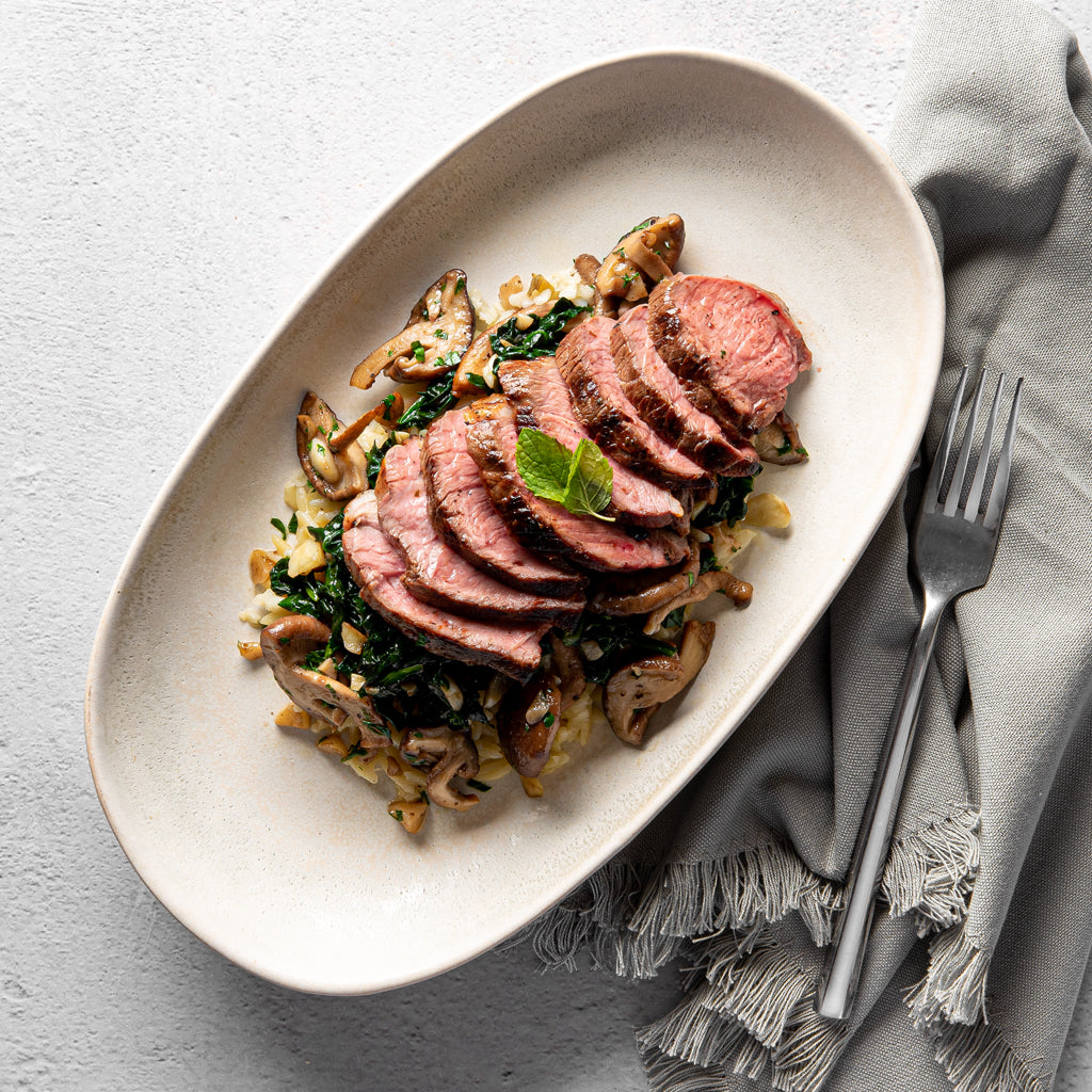 Harissa Roasted Lamb, Asiago Orzo, Sautéed Spinach and Braised Maitake Mushrooms - Homebistro