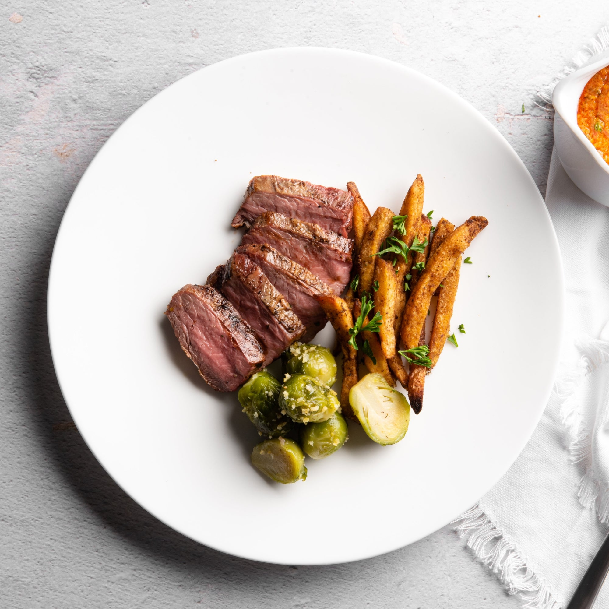 Hanger Steak with Romesco Sauce, Za'atar Oven Fries and Brussels Sprouts - Homebistro