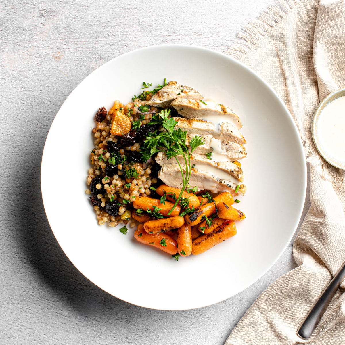 Mediterranean Chicken Breast with Orange Honey Labneh Sauce, Israeli Couscous and Honey Roasted Carrots - Homebistro