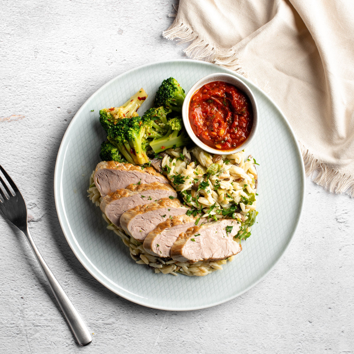 Peri-Peri Pork Tenderloin with Pecorino Romano Orzo and Spicy Chili Broccoli - Homebistro