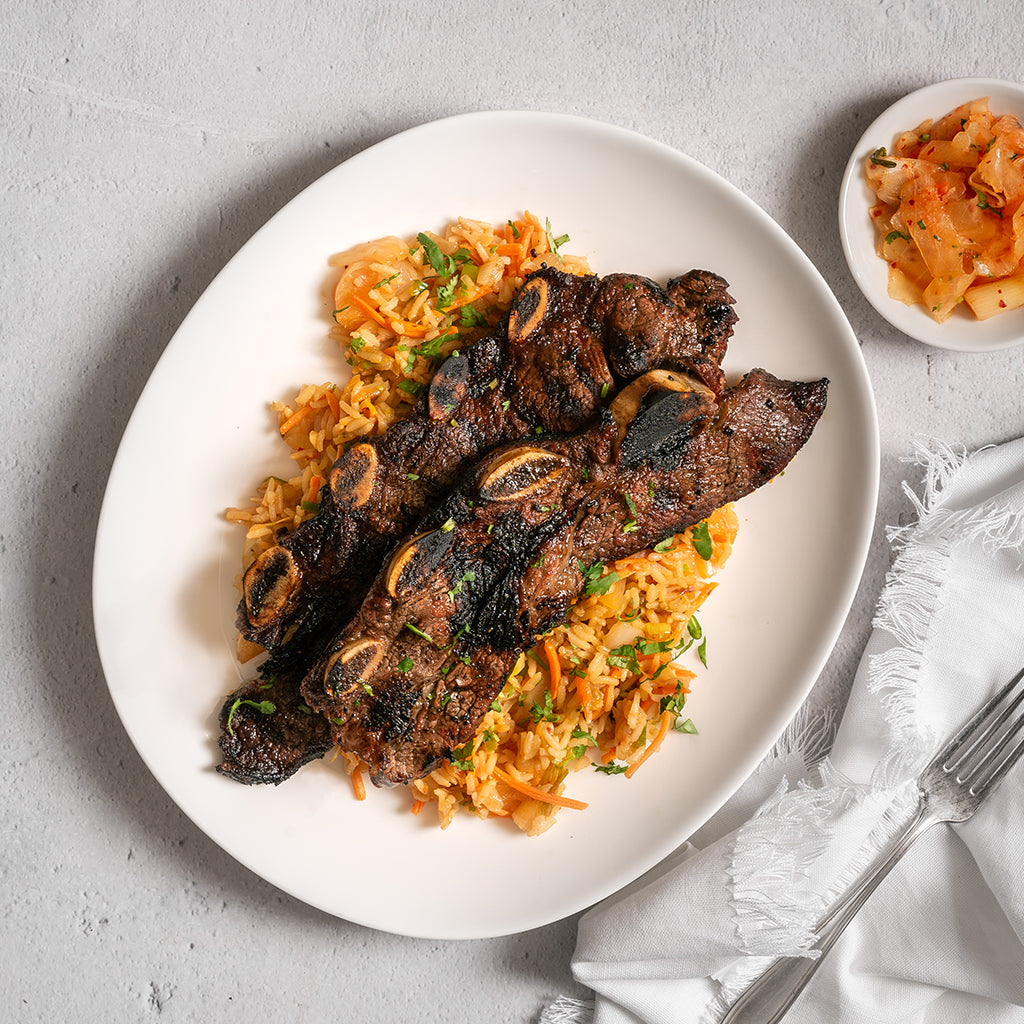 Korean BBQ Short Ribs with Kimchi Vegetable Fried Rice and Tangy Galbi Style Marinade - Homebistro