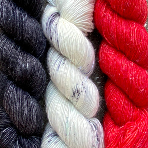 Trio of Merino Linen (fingering weight), Christmas Red, White Lynx & Noir