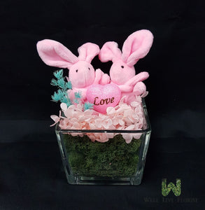 02 Pink Bunny and Preserved Hydrangea with Dried Foliage in Clear Vase.